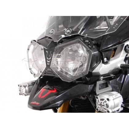 F004 Protector de faro principal. Triumph Tiger 800 10-14 / Tiger 800 XC 10-14 / Tiger 800 XC/XCx/XCa 15- / Tiger 800 XR/XRx/XRt 15- / Tiger Explorer 11- / Tiger Explorer XC 11-
